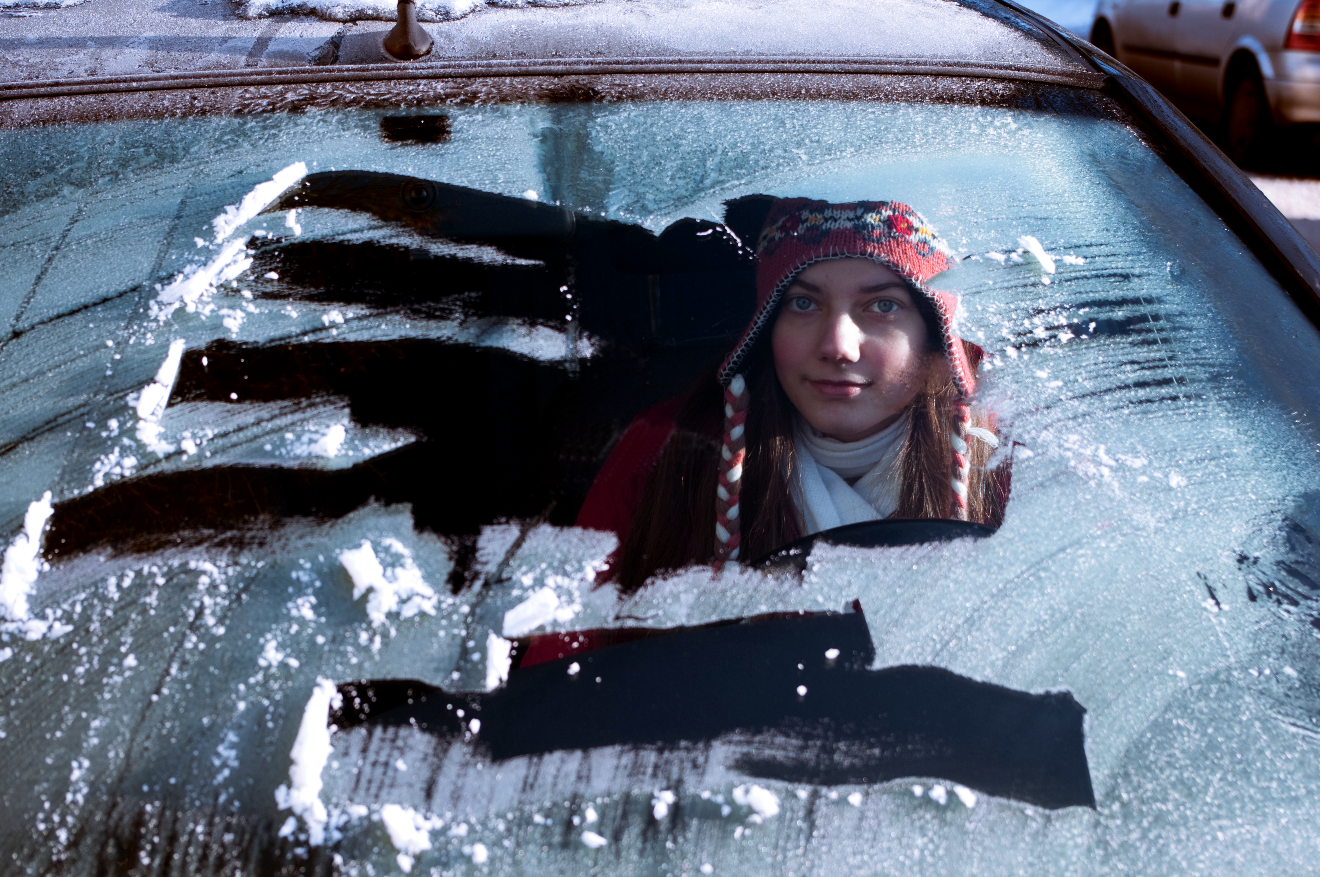 Young female driving a car, but did not scrap all of the snow off of the windshield.>From Media Library>From Media Library>From Media Library