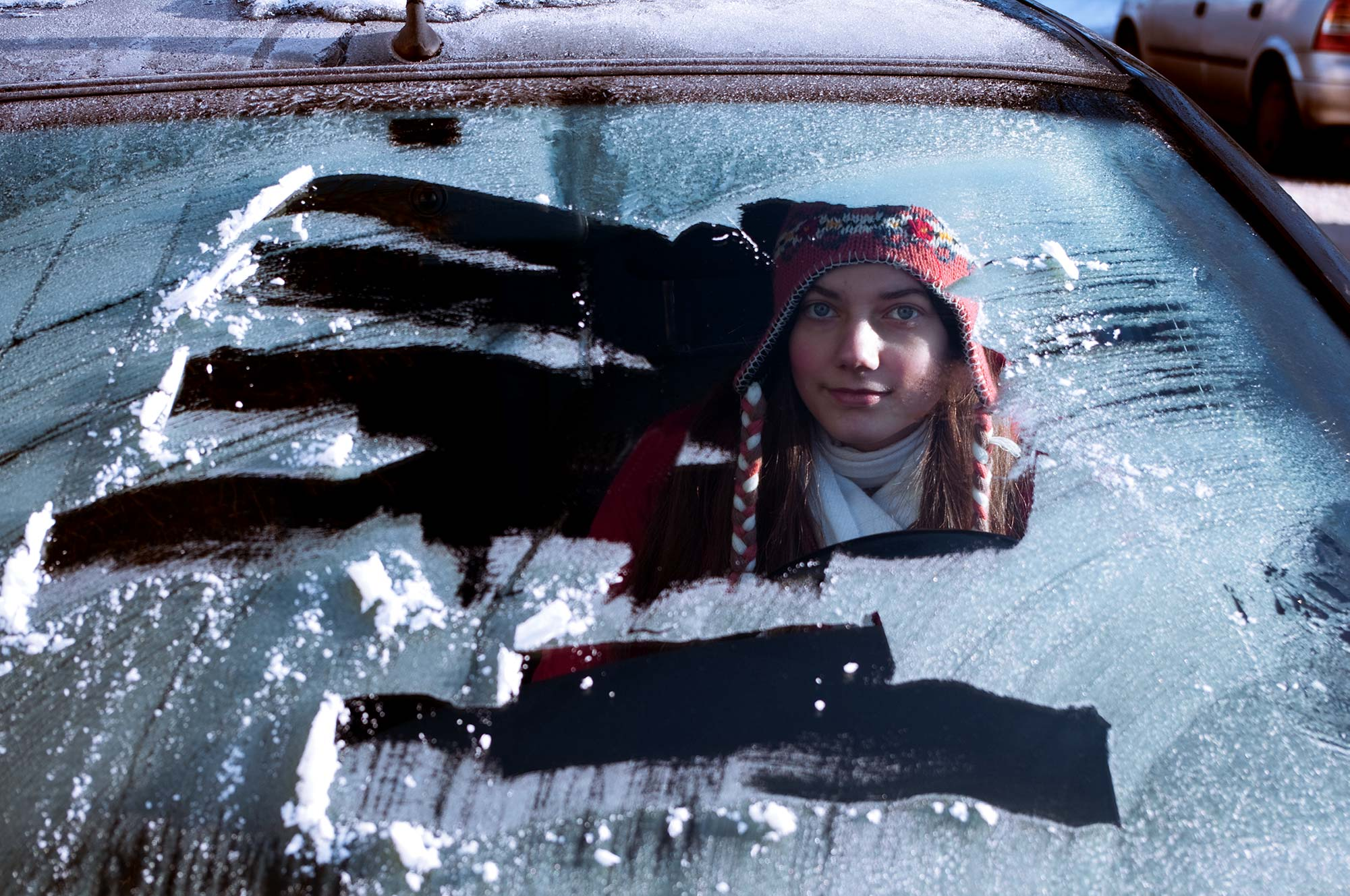 Young female driving a car, but did not scrap all of the snow off of the windshield.>From Media Library>From Media Library>From Media Library>From Media Library>From Media Library>From Media Library>From Media Library